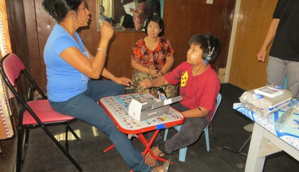 An audiologist measuring hearing levels