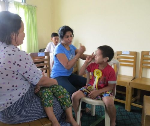 Testing the hearing with a parent observing