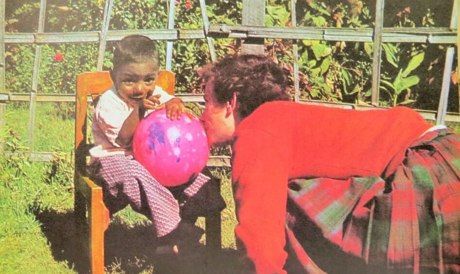 Sandra teaching Paul